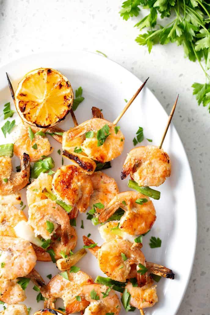 grilled shrimp on skewers on platter