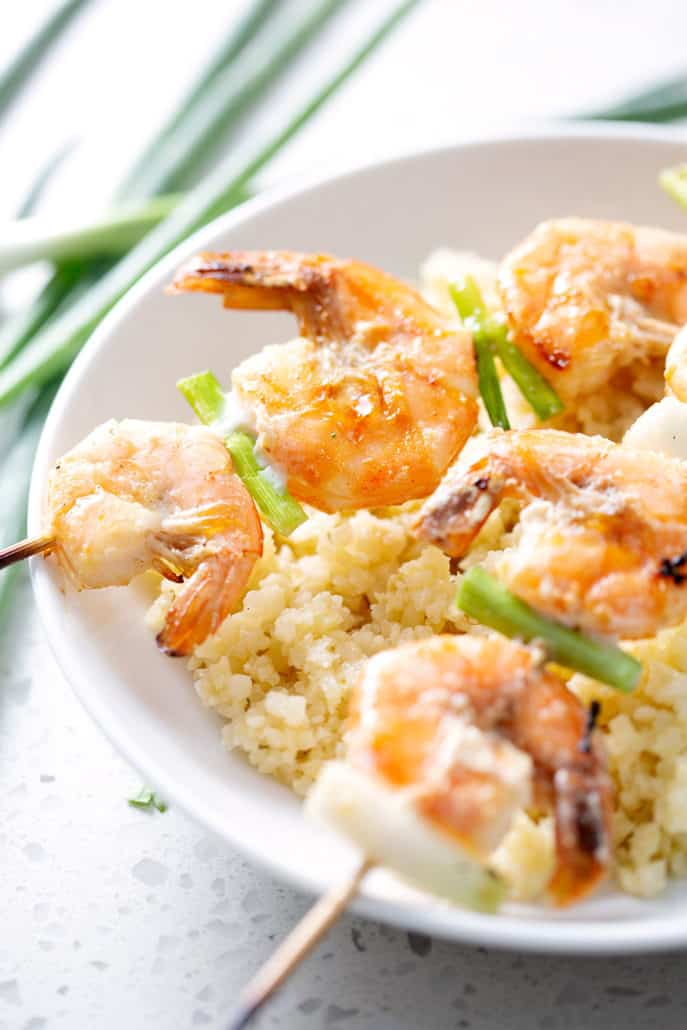 grilled shrimp and green onions on skewers