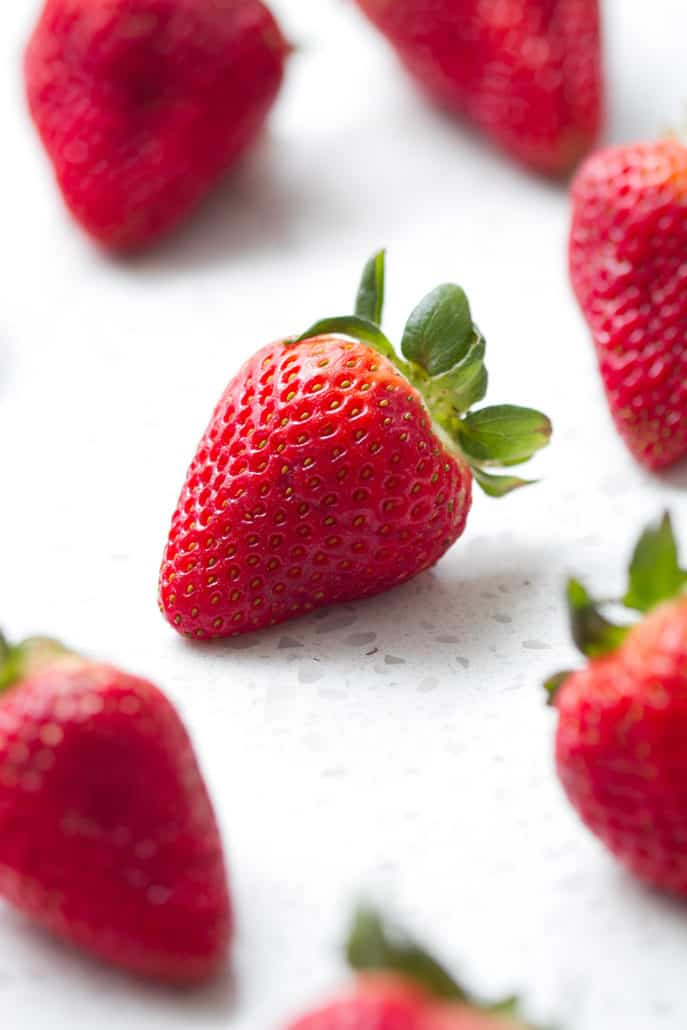whole strawberries on white background