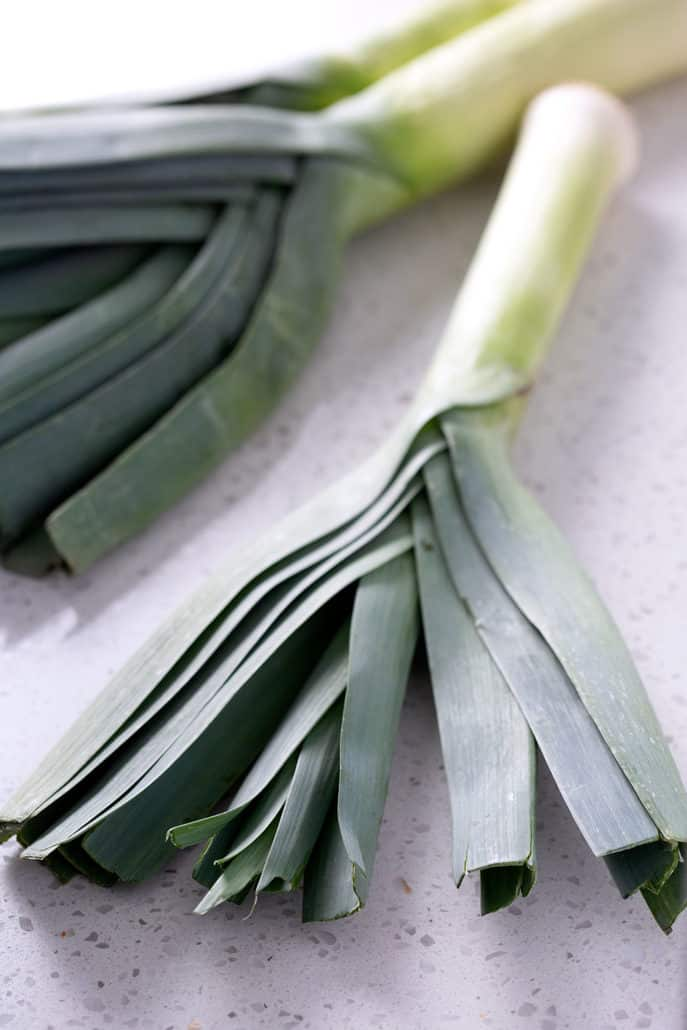 leeks on white countertop