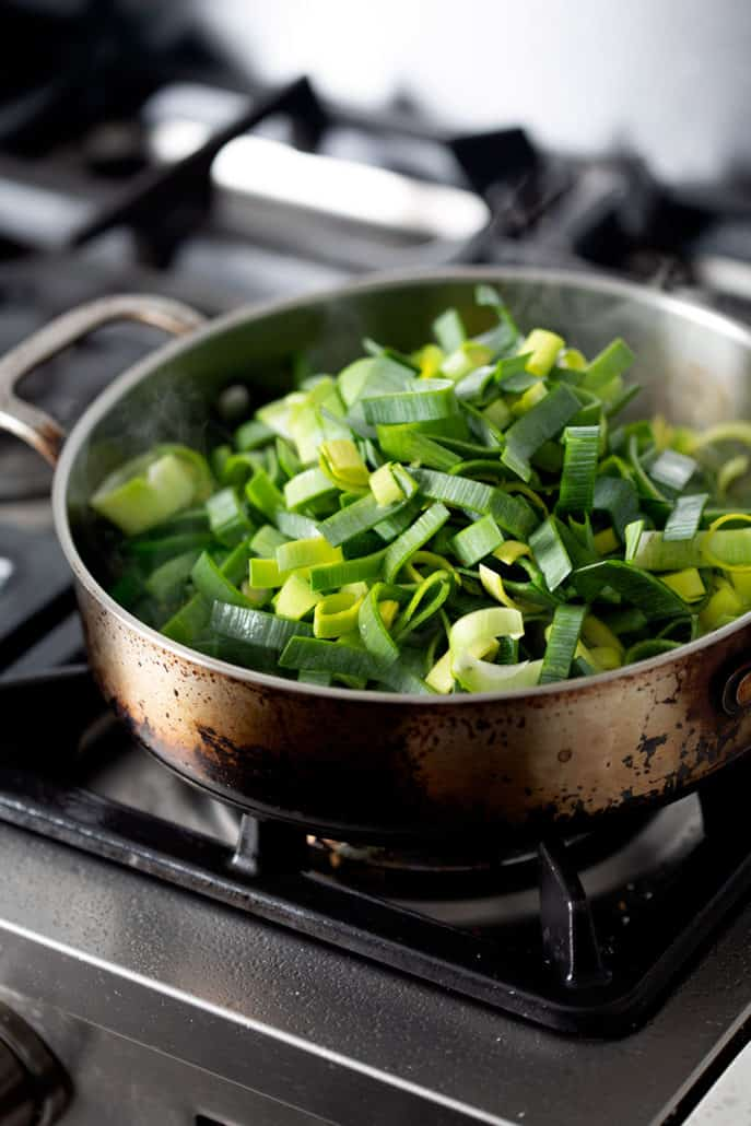 leeks green in saute pan on stovetop