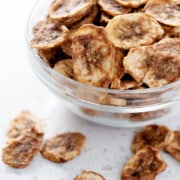 bowl of dehydrated banana chips on white counter