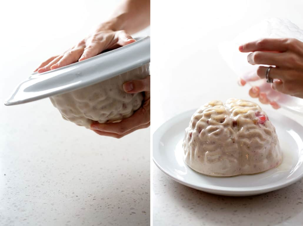 flipping brain jello mold onto plate and removing mold on white background