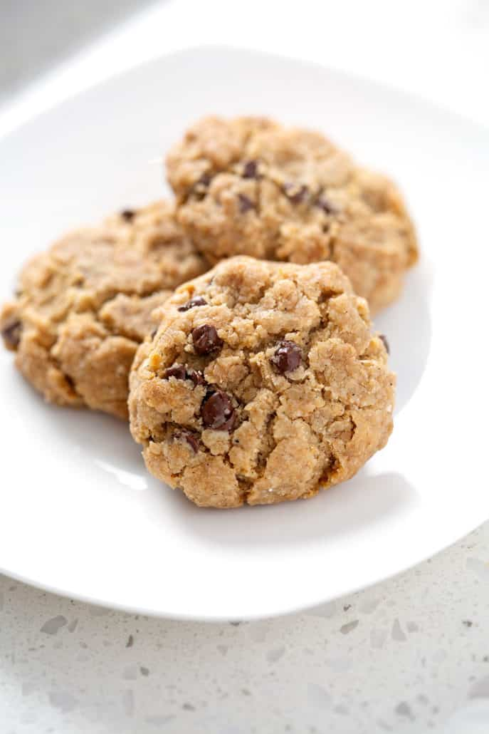 close up of white plate of chocolate chip cookies