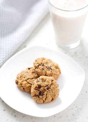 plate of aip chocolate chip cookies with glass of milk