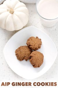 aip ginger cookies aka aip gingersnaps surrounded by pumpkin and glass of milk