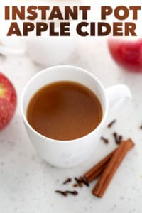 mug of apple cider and words instant pot apple cider