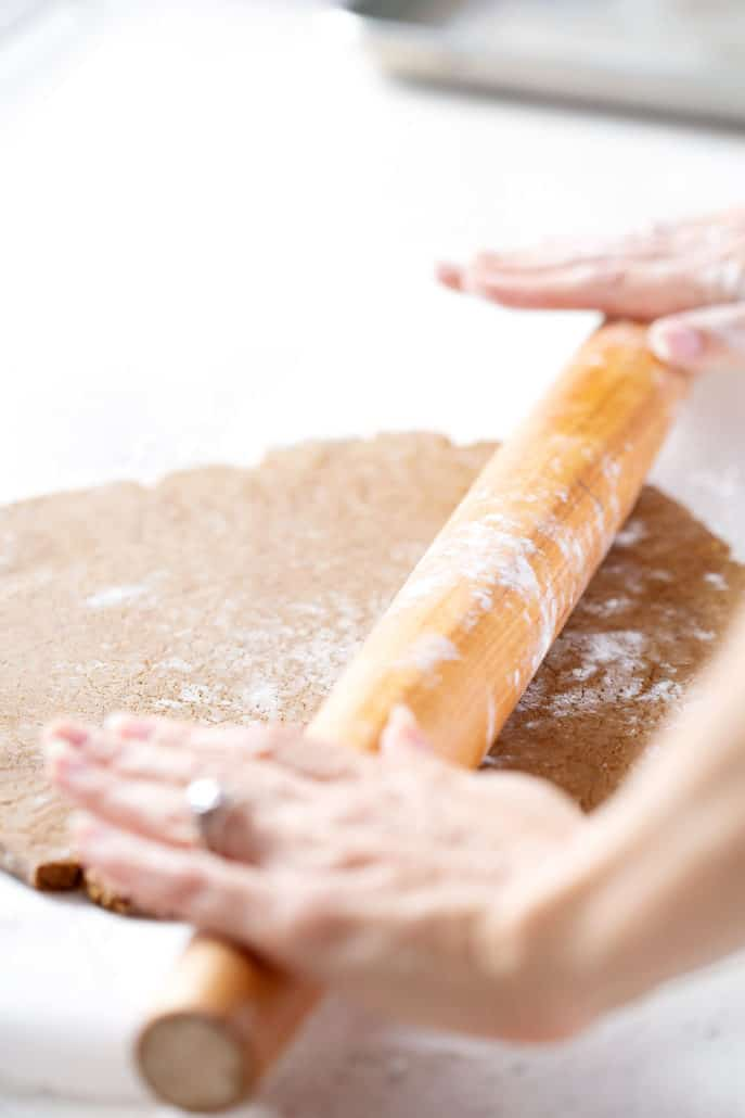 rolling out aip gingerbread cookie dough with rolling pin