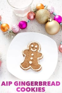 aip gingerbread cookies on white plate with Christmas decorations