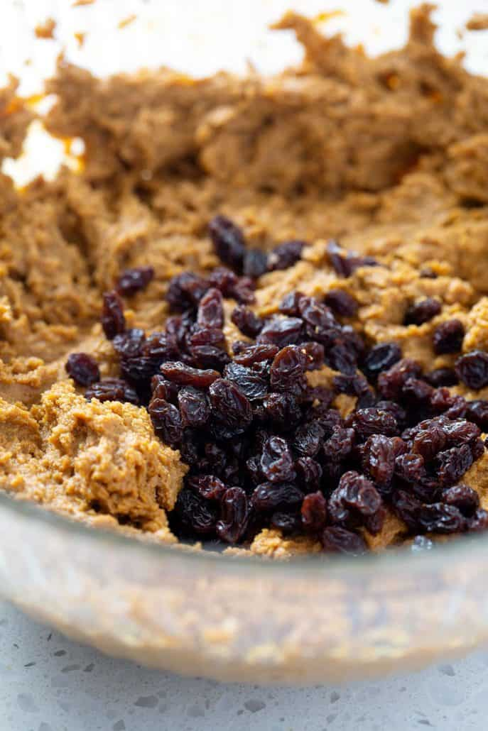 close up of bread dough with raisins