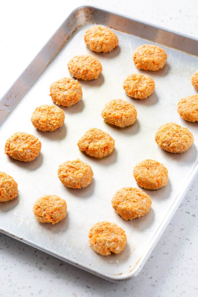 sweet potato chicken poppers on baking sheet ready to be baked
