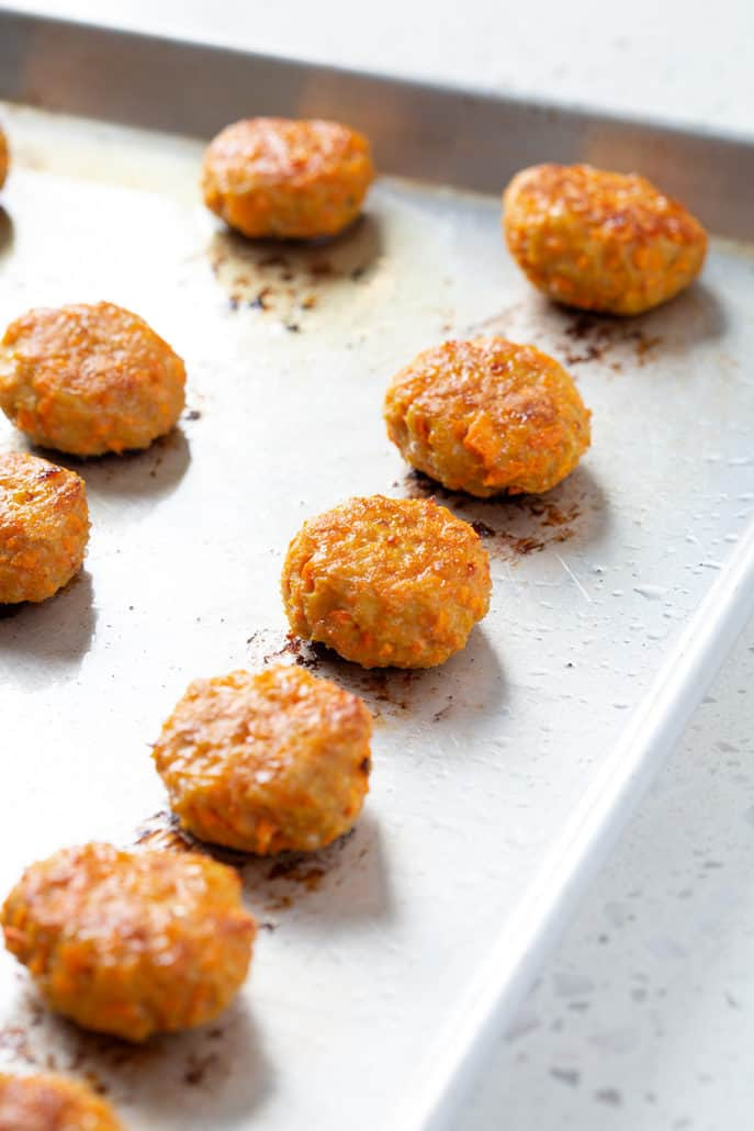baked sweet potato chicken poppers on baking sheet