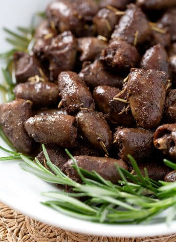 close up of rosemary chicken hearts