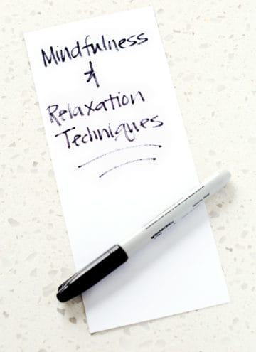 piece of paper with the words mindfulness and relation techniques and a sharpie