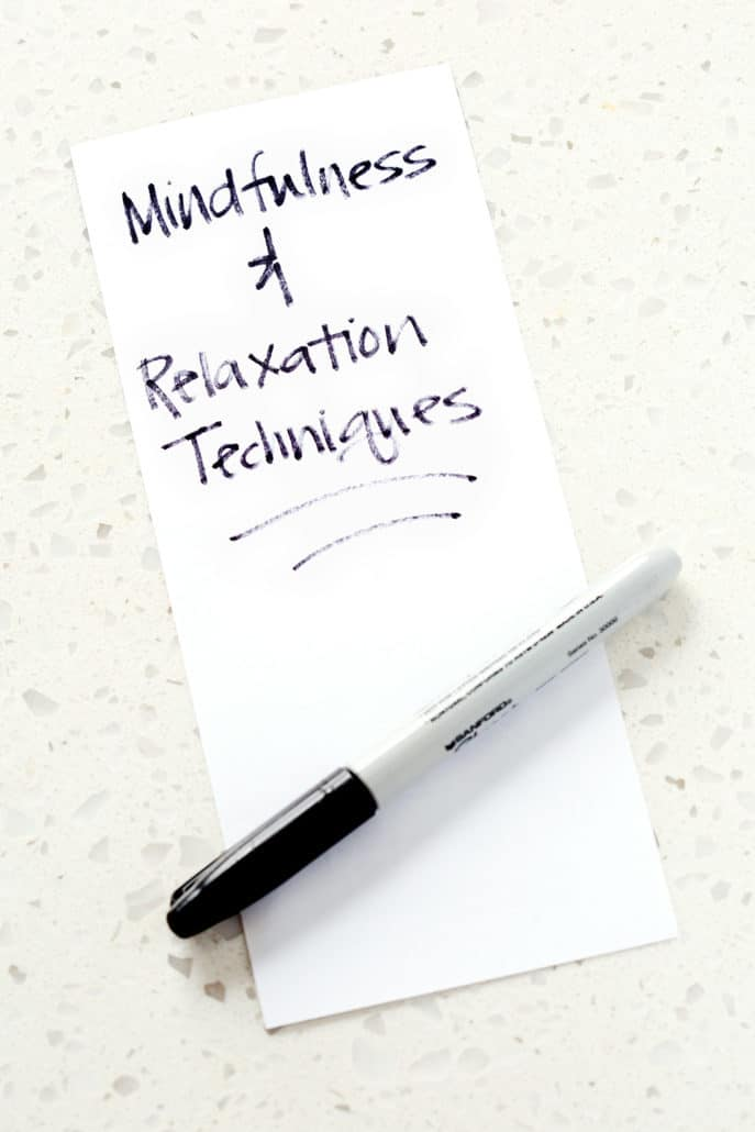 piece of paper with the words mindfulness and relaxation techniques written out and a sharpie