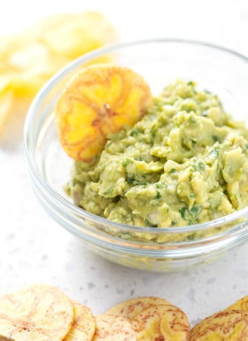 bowl of AIP Guacamole with plantain chip