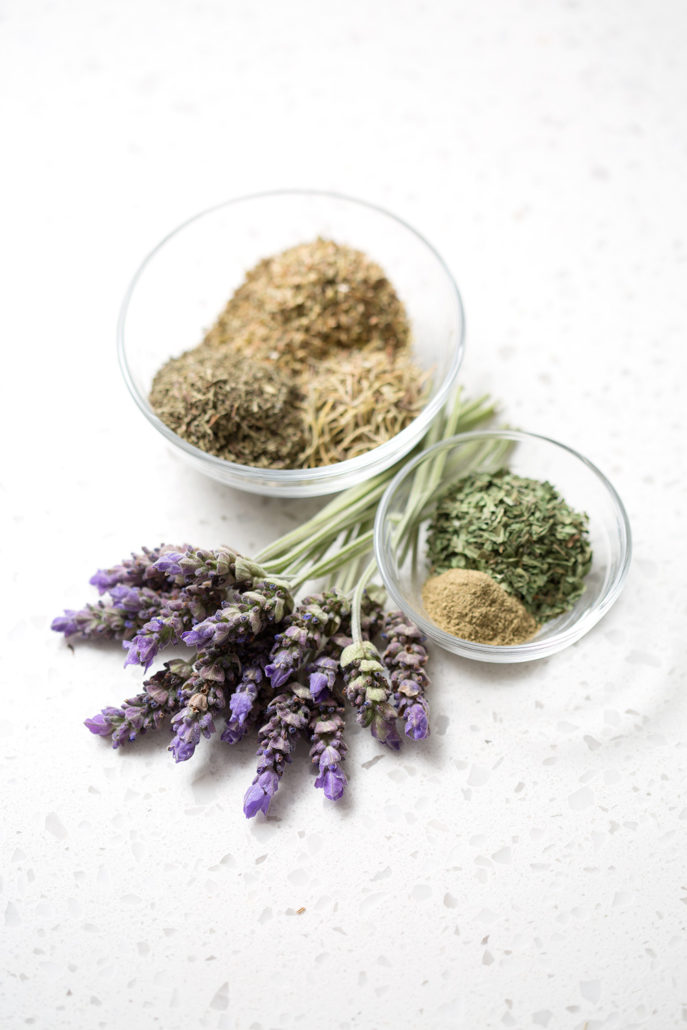 dried herbs and spices on white background