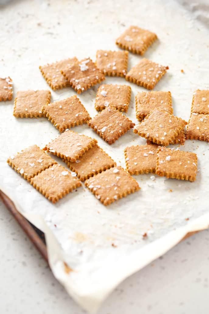 AIP Cassava 'Cheese' Crackers on parchment lined baking sheet