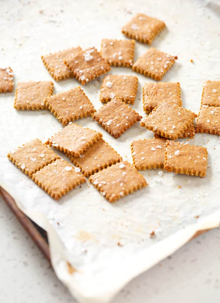parchment lined baking sheet with AIP Cassava 'Cheese' Crackers