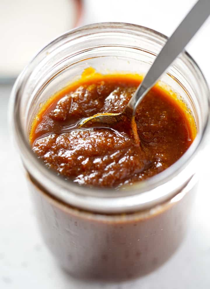 spoon in AIP BBQ Sauce in mason jar