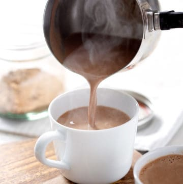 pouring AIP Hot 'Chocolate' into mug with steam