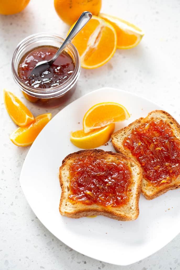 Instant Pot Orange Marmalade on toast and in mason jar