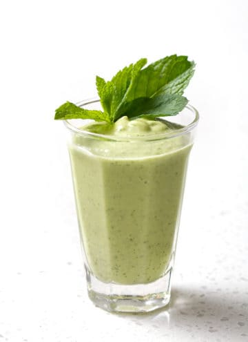 glass of AIP Avocado Smoothie on white background