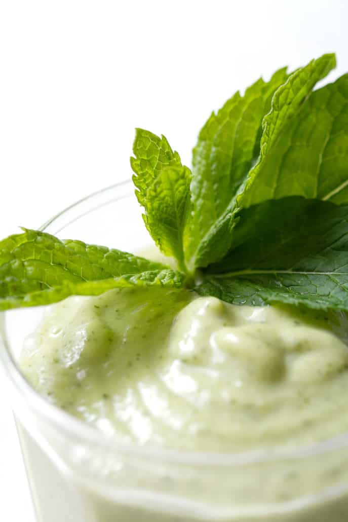 close up of AIP Avocado Smoothie with mint garnish