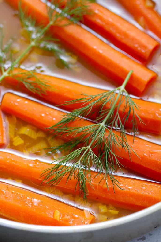 AIP Braised Carrots in pan with fresh dill garnish