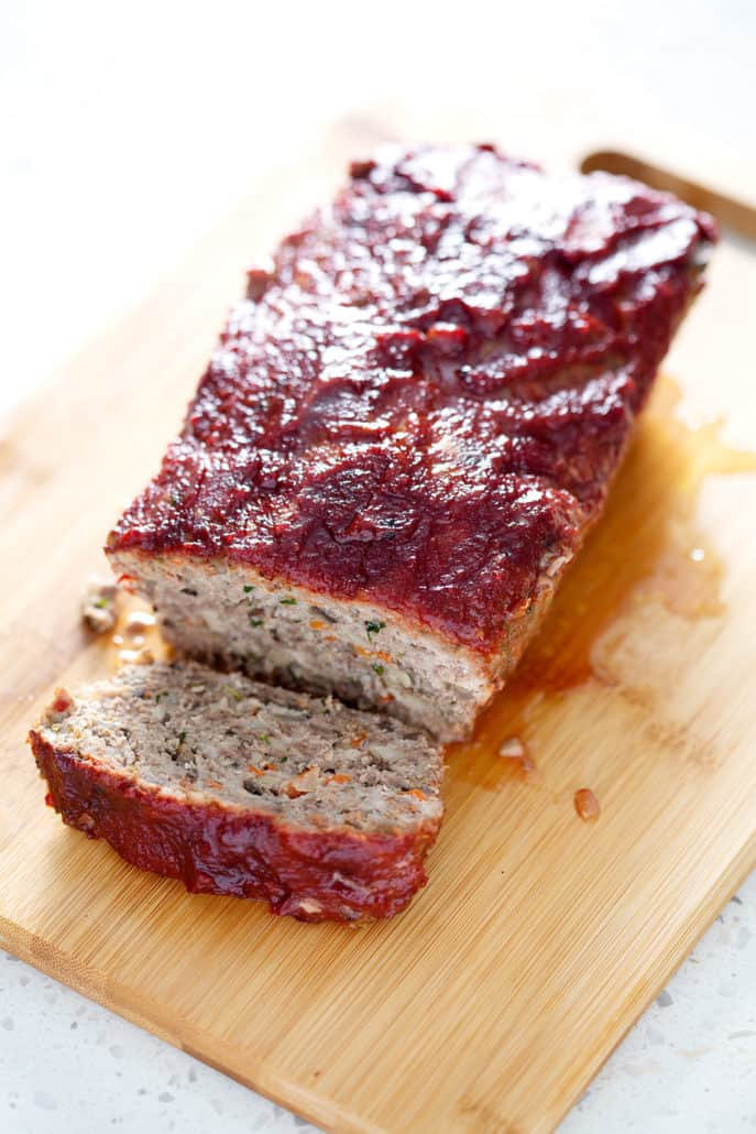 AIP meatloaf on cutting board with AIP ketchup