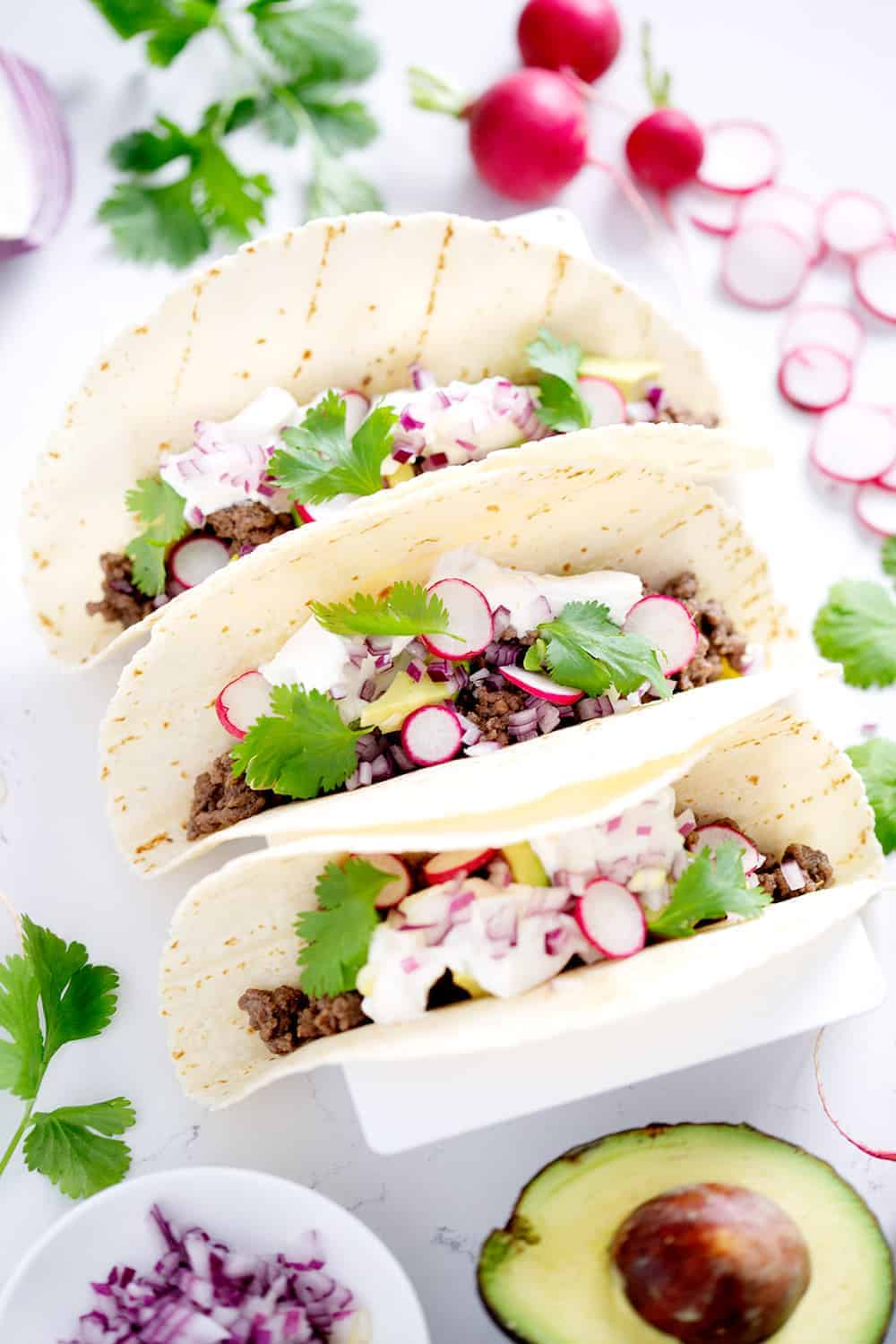 AIP Tacos surrounded by toppings
