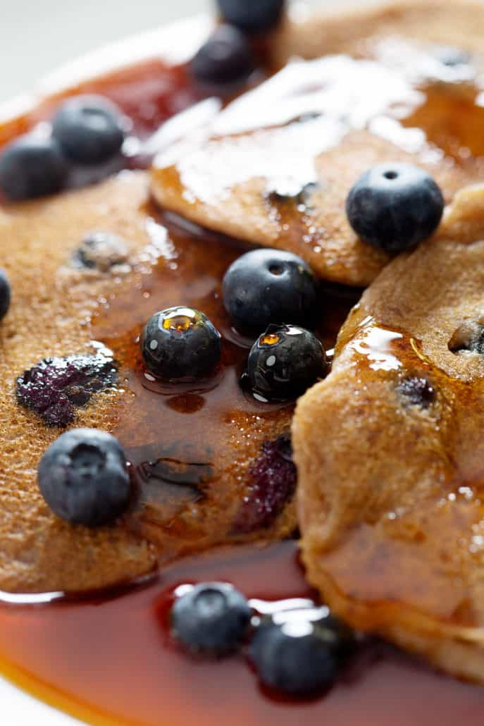 close up of AIP Blueberry Pancakes with maple syrup