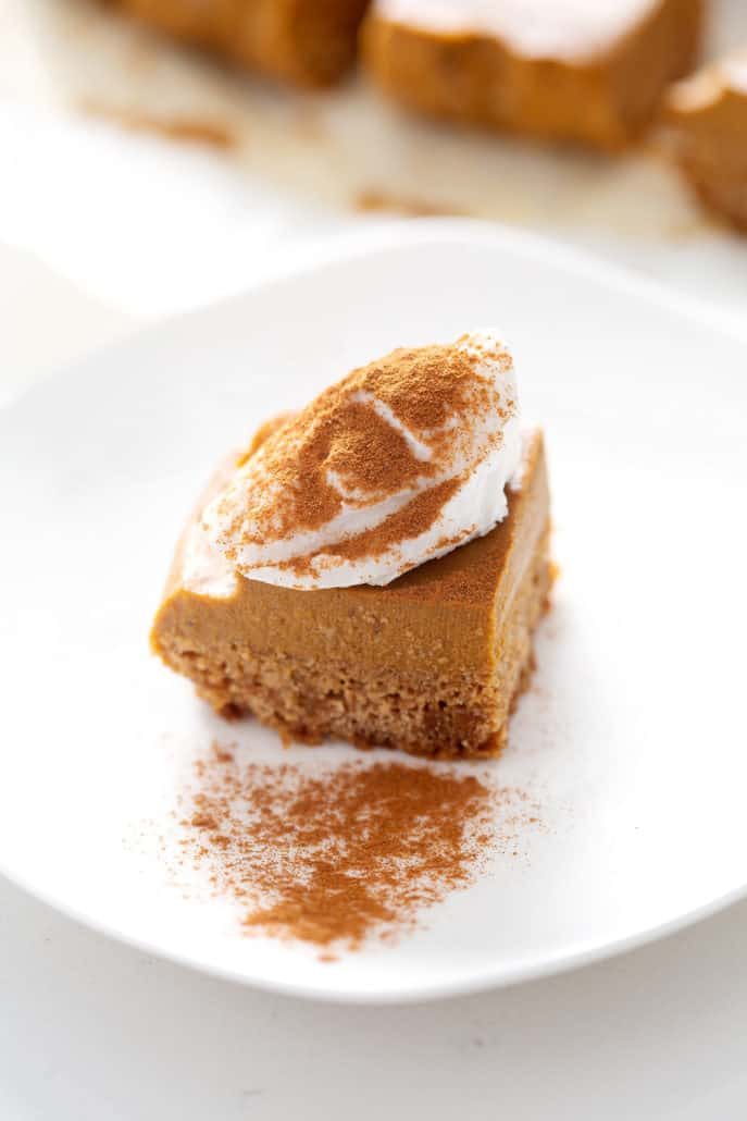 piece of AIP Pumpkin Pie Bars with topping on white plate
