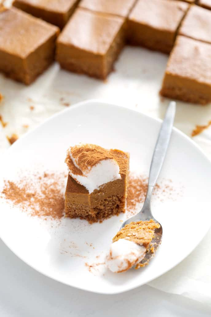 spoonful of AIP Pumpkin Pie Bars on plate with topping